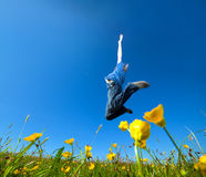 Freedom jump on the field Royalty Free Stock Images