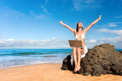 Freedom laptop. Woman smiling with laptop computer on tropical beach Stock Photos