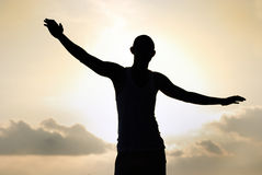 Freedom man. In silhouette view Stock Photos