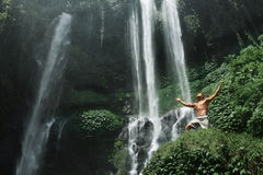 Freedom. Man Feeling Free With Hands Up Near Waterfall. Freedom Man. Free Happy Healthy Male Relaxing Near Beautiful Paradise Waterfall With Hands Up, Enjoying Stock Images