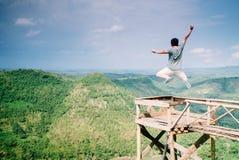 Freedom. A man jumping at kediwung yogyakarta Stock Image