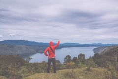 Freedom man standing on top of Lake toba, medan, Indonesia Royalty Free Stock Images