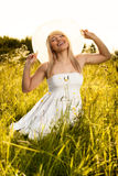 Freedom in the meadow. Young woman in the meadow stock images