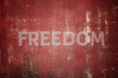 Freedom message written on cracked concrete Stock Photo
