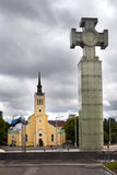 Freedom monument , is devoted to Emancipating war  and St. John's Church, 1860 on Freedom Square. Tallinn, Estonia. Stock Photo