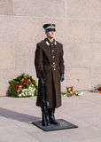 Freedom Monument Guard. A soldier of the Latvian National Armed Forces guards the Freedom Monument in Riga. The monument honours soldiers killed in the Latvian stock photos