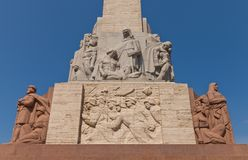 Freedom Monument in Riga, Latvia (fragment). Riga, Latvia - May 25, 2014: Right side of the Freedom Monument in Riga (Latvia). Figure groups Guards of the stock photo