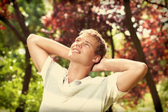 Freedom morning. Young man standing in the garden summertime stock photo