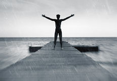 Freedom in nature concept - free man in the rain stock image