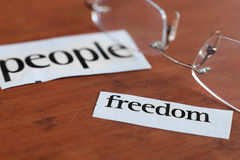 Freedom for people. People freedom cut out labels from the newspaper. Human concept Royalty Free Stock Image