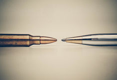 Freedom of the press. Pen vs. Bullet / Freedom of the press is at risk concept / World press freedom day concept Royalty Free Stock Image