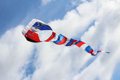 Kite in sky. Red White and Blue kite flying in the summer breeze stock image