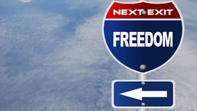 Freedom road sign with flowing clouds Stock Photos