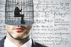 Freedom and science background. Cage headed businessman on concrete wall background with mathematical formulas. Freedom and science concept Royalty Free Stock Photo