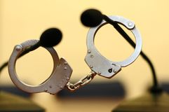 Freedom of speech. Pair of handcuffs on two microphones Royalty Free Stock Images