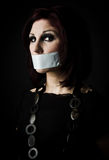 Freedom of speech. Artistic portrait of woman with tape over her mouth, signifying freedom of speech Royalty Free Stock Photography