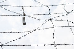 Freedom of speech. Phone hanged on the barbed wires royalty free stock photography