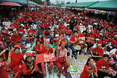 Freedom of Speech Rally. Red-shirt demonstrators join a large rally on the Royal Plaza to protest against Thailand's strict Lese Majeste law and legal restraints Stock Image