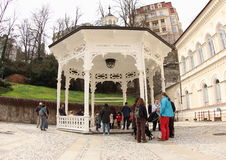 Freedom Spring Arbour. Tourists in front of Freedom Spring (Pramen Svoboda), Carlsbad, Western Bohemia, Czech Republic. The spring covered by an octagonal walk Royalty Free Stock Photos