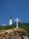 Freedom Statue and cross. Freedom Statue (Szabads�g szobor) and Cross on Gellert Hill (Gell�rt-hegy) in Budapest, Hungary, Europe Royalty Free Stock Photography
