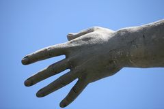 Freedom stretched the hand up. Against the blue sky, monument close to Royalty Free Stock Image