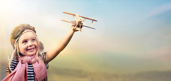Freedom To Dream - Joyful Child Playing With Airplane. Against The Sky Royalty Free Stock Photos