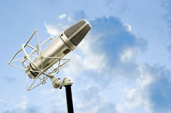 Freedom to sing. Microphone with blue sky royalty free stock photo