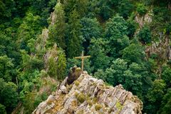 freedom on the top of a hill with a cross Stock Images