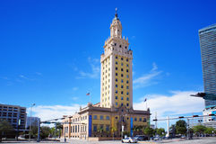 Freedom Tower of Miami Downtown. Miami, United States - February 12, 2016: People and cars move alongside the Freedom Tower, touristic attraction building, in Stock Photo