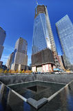Freedom Tower and National September 11 Memorial. Freedom Tower being built by the National September 11 Memorial at the World Trade Center site in New York City Royalty Free Stock Photography
