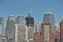 Freedom Tower - World Trade Center. A shot of Freedom Tower in construction, surrounded by buildings in new york city, usa Stock Photo