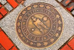 Freedom Trail Marker, Boston. The Freedom Trail, a 2 mile path through Boston History, has brass markers directing the tourists Royalty Free Stock Photography
