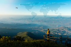 Freedom traveler man relaxing on top of a mountain. And enjoying the view of valley Stock Photography