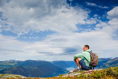 Freedom traveler man sitting upper the fjord and enjoying a beautiful nature Royalty Free Stock Images