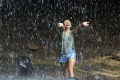 Freedom in waterfall Stock Photo