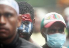 Freedom of west papua. Dozen of Papuan student takes part on a rally in Solo, Central Java, Indonesia, December 19, 2013. they are demanding the freedom of West royalty free stock photo