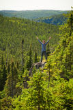 Young man on a rock in the middle of the nature Stock Photos