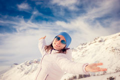 Freedom winter mountain woman Stock Photography