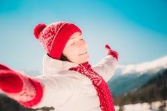 Freedom winter mountain woman Stock Photo