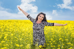 Freedom woman in canola field Stock Photography
