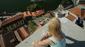 Freedom woman at Douro River. Carefree woman with seagull looking picturesque Porto and Ribeira district skyline. Aerial view of Dom Luis I Bridge on Douro River stock video footage