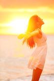 Freedom woman enjoying feeling happy free at beach. At sunset. Beautiful serene relaxing woman in pure happiness and elated enjoyment with arms raised Royalty Free Stock Photography