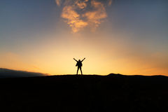 Freedom woman enjoying happiness. And beautiful sunset sky Royalty Free Stock Photography