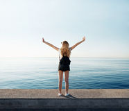 Freedom woman happy and free open arms on beach at sunny sunrise Royalty Free Stock Image