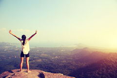 Freedom woman open arms on mountain peak Stock Images