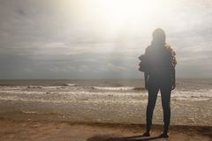 Women on the beach. Freedom woman silhouette Lonely alone on the beach with light on top, female adult at holidays in Asia Thailand Royalty Free Stock Photography