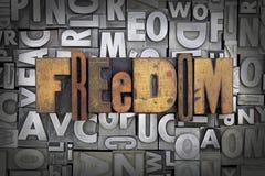 Freedom. Written in vintage letterpress type stock photo