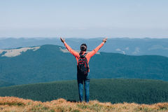 Freedom young girl with hands up in mountains Royalty Free Stock Photo