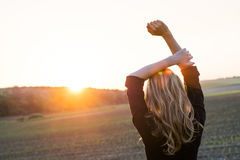 Freedom. Young woman feel freedom at sunset / sunrise Royalty Free Stock Photo