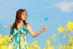 Freedom, young woman outdoor. Playing like a child with handmill Stock Photography